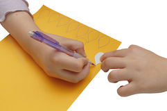 Child hands make outline with pencil Royalty Free Stock Images