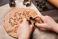 Child hands making festive Christmas gingerbread cookies. Closeup royalty free stock photography