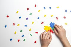 Child hands making multicolored heart on white background. Top view royalty free stock photos