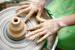 Child hands making pottery Royalty Free Stock Photos