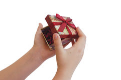 Child hands opening a gift box with red ribbon Stock Photo