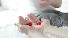The child hands out his red heart in his mother`s hands. stock video