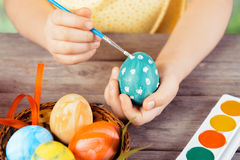 Child hands paint egg Royalty Free Stock Image