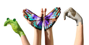 Child hands painted in colorful paints or tattoo on white royalty free stock photography