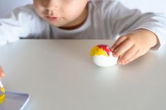Colouring eggs for easter time at home. royalty free stock photo