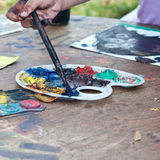 Child hands painting. Close up photo Stock Images