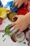 Child hands in paints Stock Photos