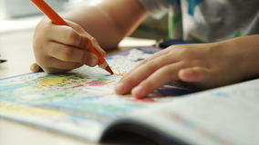 Child hands paints a colored pencils on a paper stock video footage