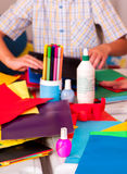 Child hands with parer and color pencils Royalty Free Stock Image