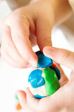 Child hands with plasticine Stock Photo