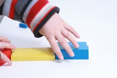 Child hands play isolated toy Royalty Free Stock Image