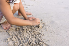 Child hands Play sand on the beach Royalty Free Stock Photos