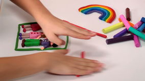 Child hands playing with modeling clay - closeup stock footage