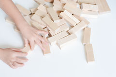 Child hands playing with wooden blocks Royalty Free Stock Photography