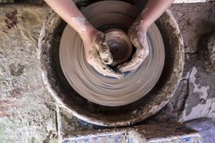 Child hands shaping bowl on potters wheel Stock Photography