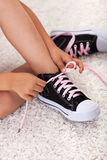 Child hands tie shoelaces Royalty Free Stock Image