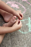 Child hands and toes. Stock Photo