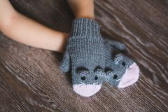 Child hands in winter mouse mittens Royalty Free Stock Photos