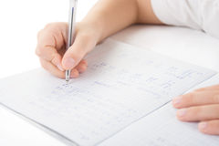 Child hands writing a homework Royalty Free Stock Images