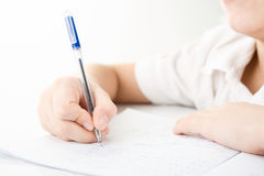 Child hands writing a homework Stock Photography