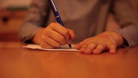 Child hands writing a letter stock video