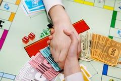 Child Handshake Playing Board Game Stock Photos