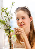 Child hang easter egg on cherry branch Stock Image