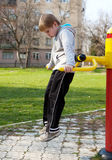 Child hanging on a bars. The small child hanging on a bars Royalty Free Stock Photos