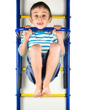 Child hanging on a horizontal bar Stock Photo