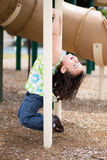 Child hanging. From playground structure Royalty Free Stock Photo