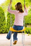Child at hanging swing Royalty Free Stock Photography