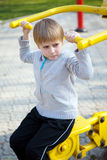 Child hanging on a training apparatus Stock Photography