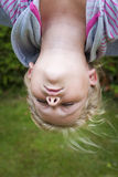 Child hanging upside down Royalty Free Stock Photo