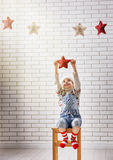 Child hangs the stars Stock Photography