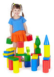 Child happily playing with colored blocks. On white stock image