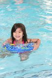 Child happily swimming Stock Photos