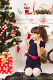 Child is happy Christmas presents Royalty Free Stock Images