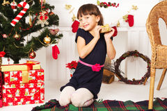 Child is happy Christmas presents Royalty Free Stock Photo