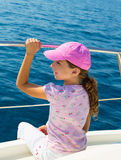 Child happy girl sailing happy  boat with cap Royalty Free Stock Images
