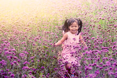 Child happy little girl  running and having fun in field Stock Image
