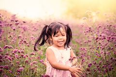 Child happy little girl running and having fun in the field Royalty Free Stock Photo
