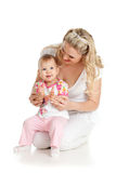 Child and happy mother are clapping. Child on loving mother's knees clapps Stock Photo