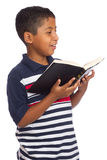 Child Happy Because He is Reading the Word of God Royalty Free Stock Photos