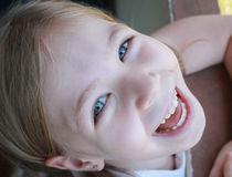 Child happy smile little girl. White baby teeth. Stock Image