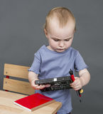 Child with hard drive and tools Stock Images