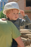 Child in hard hat Stock Images
