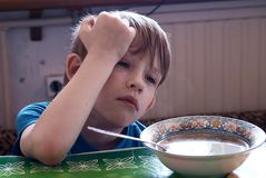 The child has breakfast Royalty Free Stock Photography
