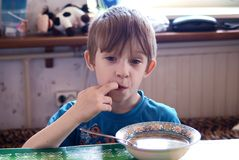 The child has breakfast Royalty Free Stock Photo