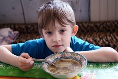 The child has breakfast Stock Photos