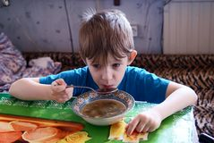 The child has breakfast Royalty Free Stock Images
